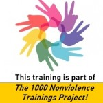 Nonviolence training hub hands and peace sign - text 1000 trainings project with link