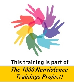 Nonviolence training hub hands and peace sign - text 1000 trainings project